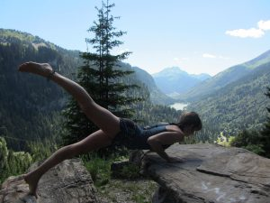One legged chaturanga on a mountain top
