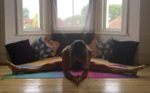 Yin yoga straddle pose