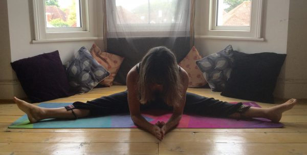 Yin yoga straddle