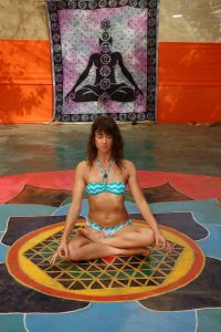 Meditation inside a mandala in a colourful yoga shala