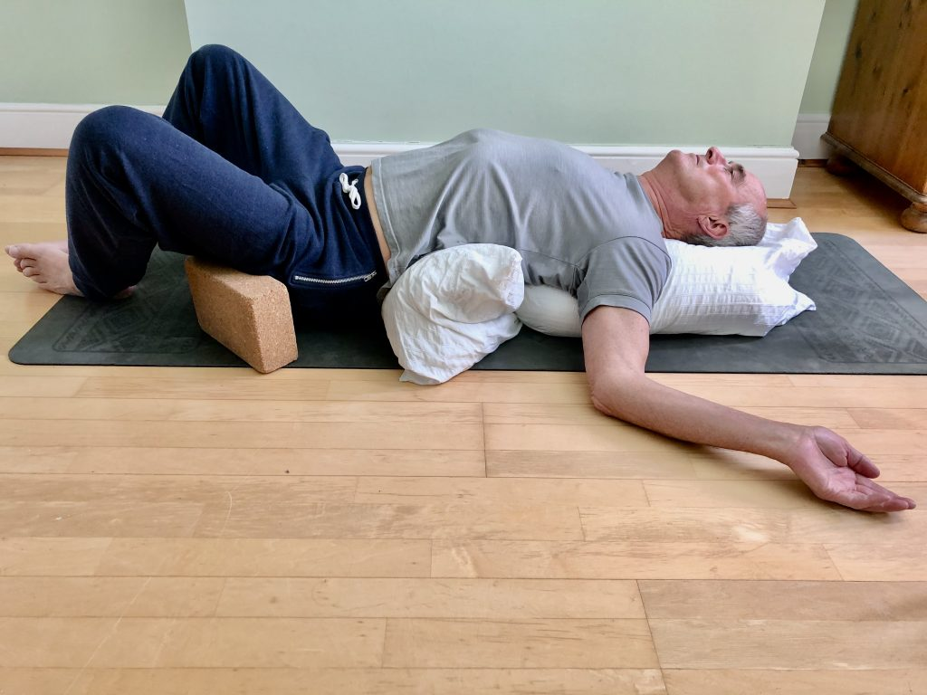 Reclining Butterfly pose as part of a yoga routine for men over 50