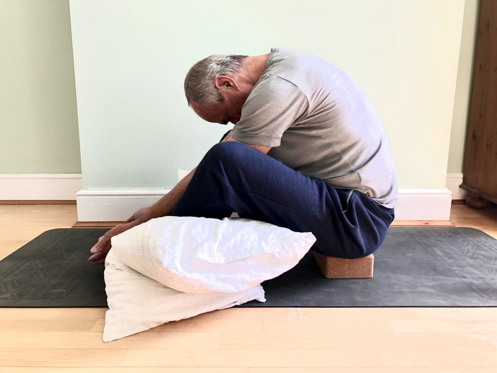 Bound angle pose with props to help with men's flexibility