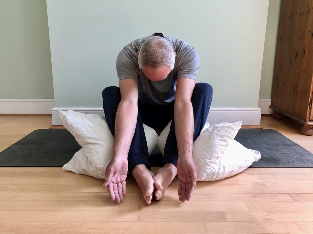 Bound Angle Pose with props to help decompress tight back and hips in men