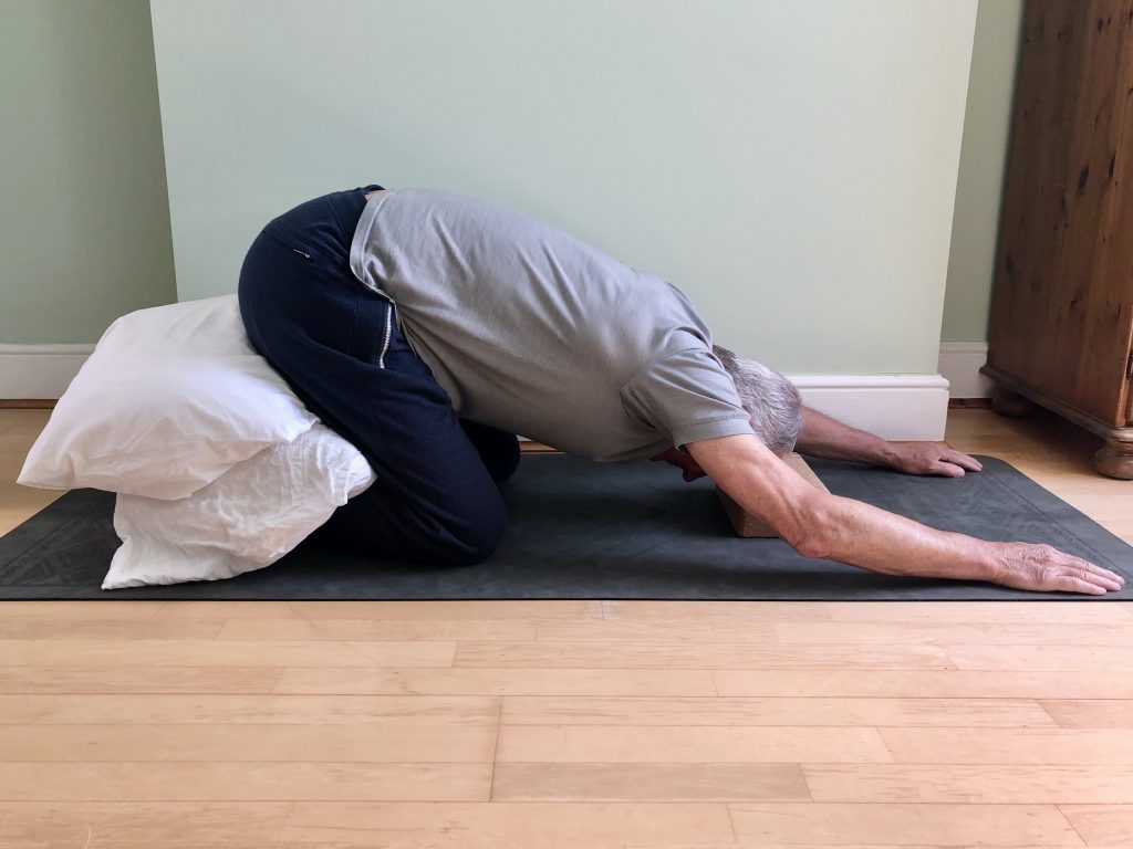 Childs pose with tightness restrictions in men's yoga